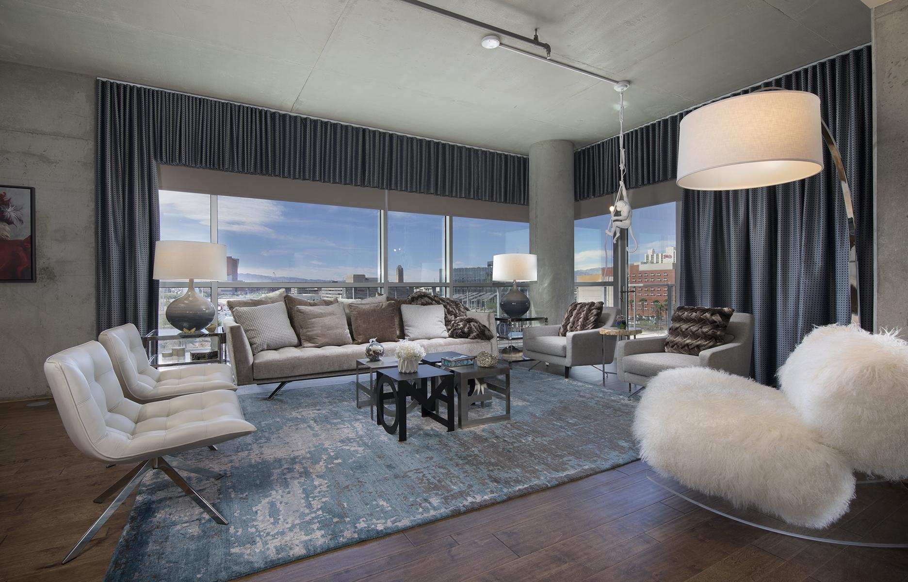 floor to ceiling windows frame open living room