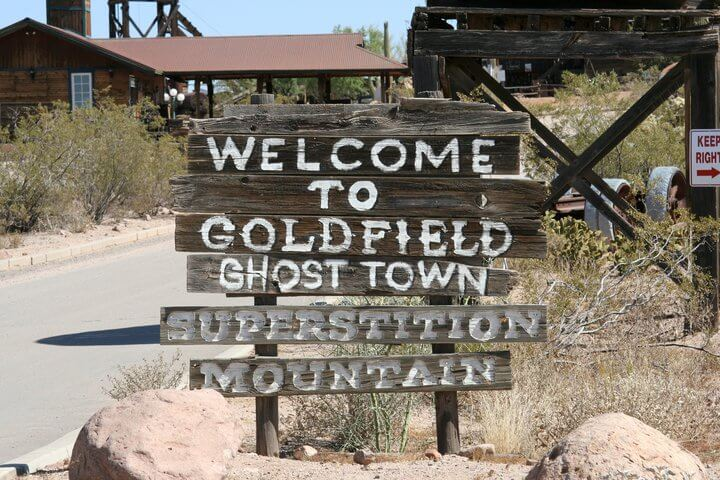 wood post mount welcome sign to goldfield ghost town sign