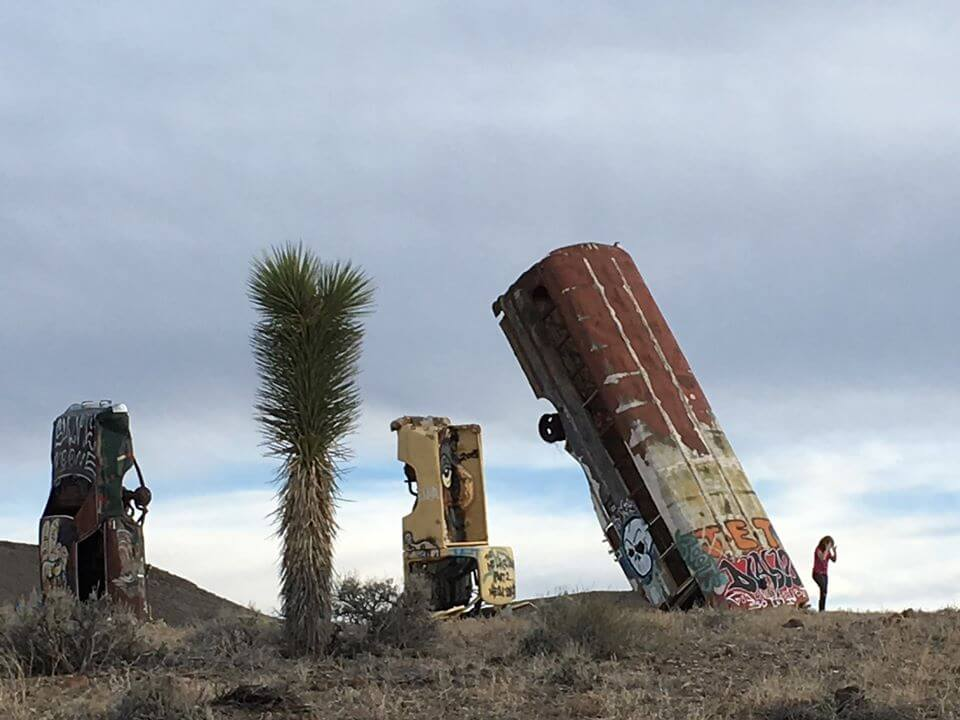 automobile art installation is shown outside in desert at international car forest