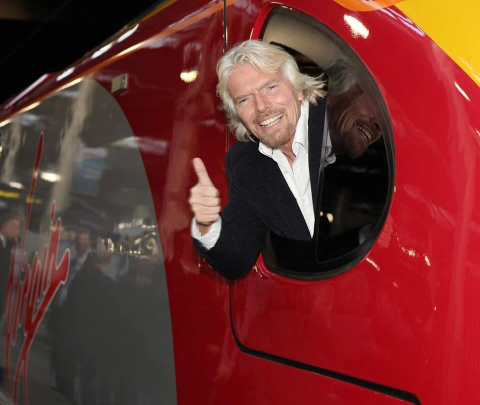 Branson from Virgin Trains Gives Thumbs Up From Train Window