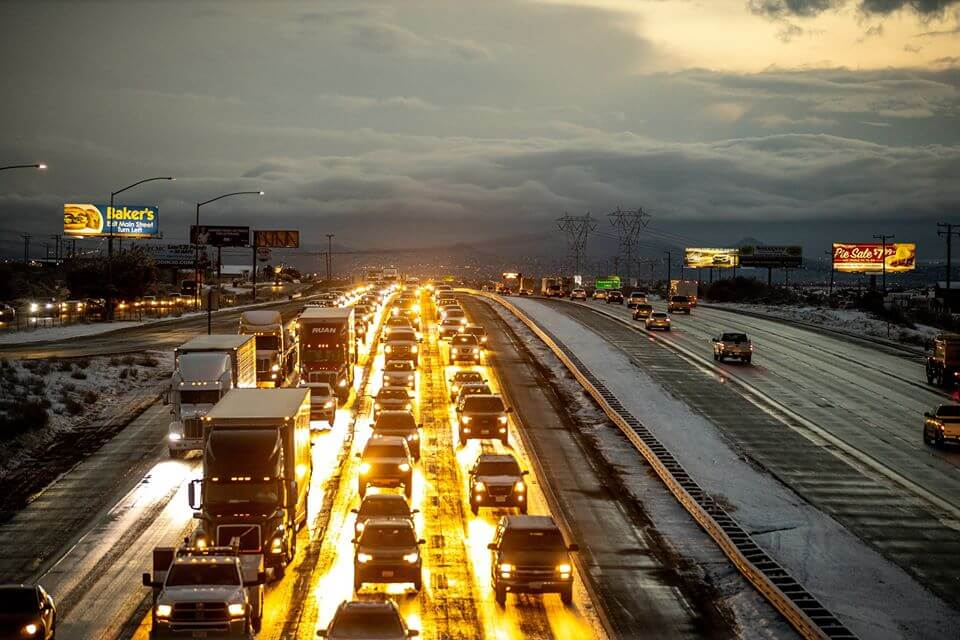 Freeway traffic on I5 between California and Nevada at Dusk