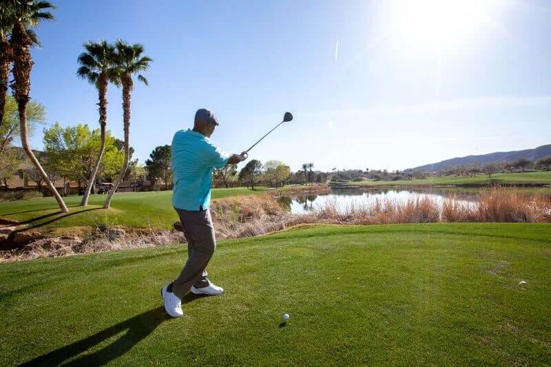 golfer tees off at Henderson golf course