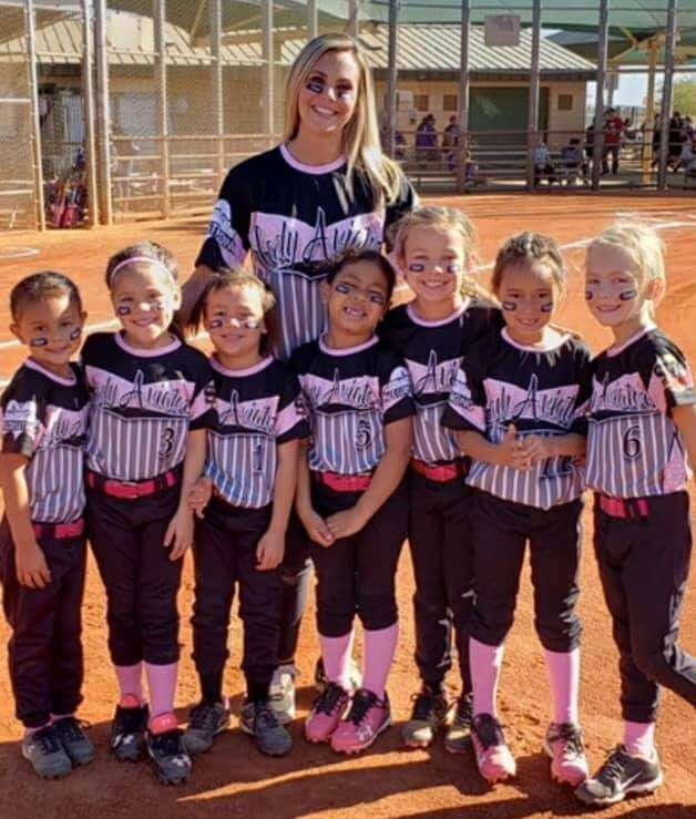south vegas girls softball team with coach stand together in uniforms
