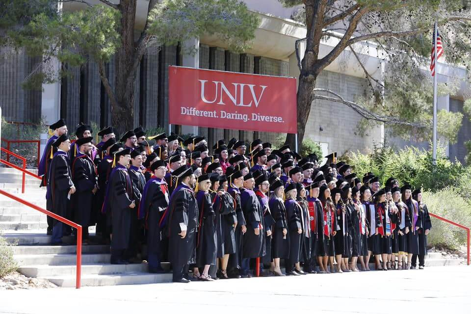 unlv graduates stand together on campus
