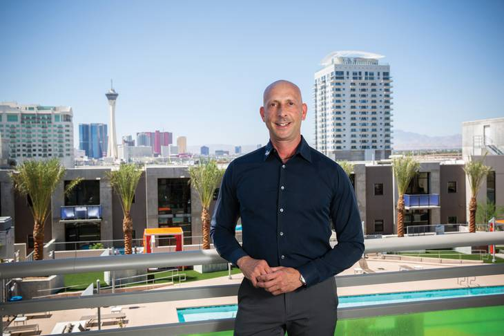 Uri Vaknin stands at Juhl condominium building in Downtown Las Vegas