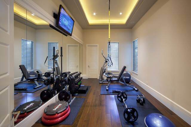 home workout room with fitness equipment