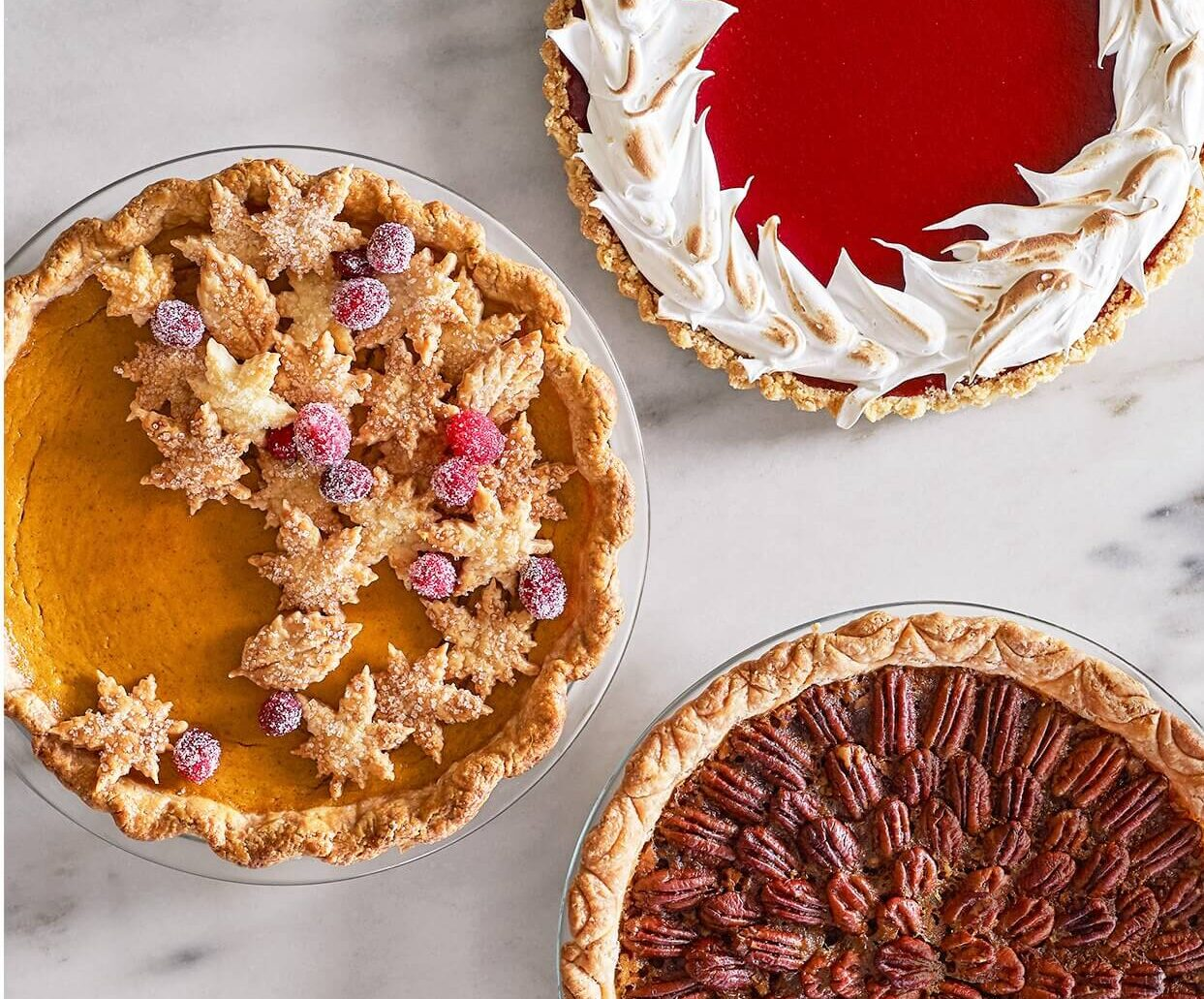 pecan, apple and pumpkin pies with thanksgiving theme