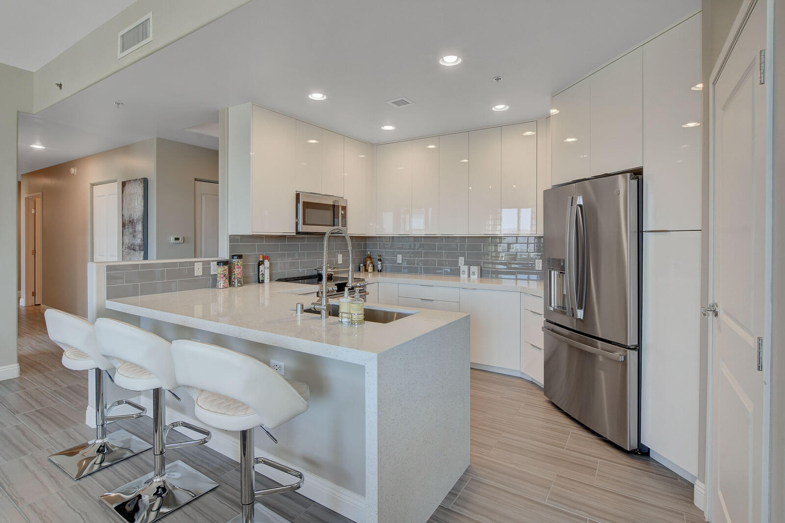 white kitchen with new stainless steel appliances