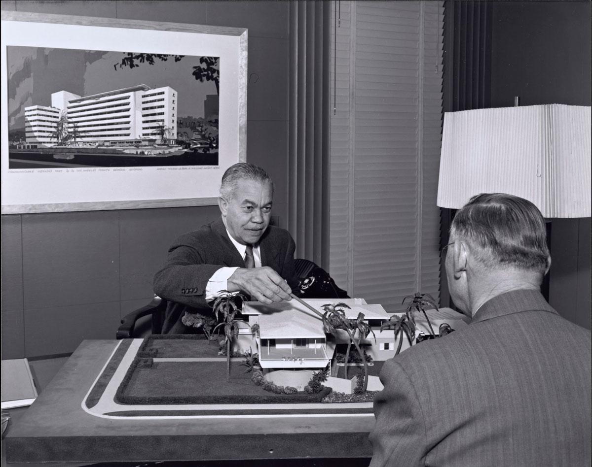 two men sit at desk in 1950