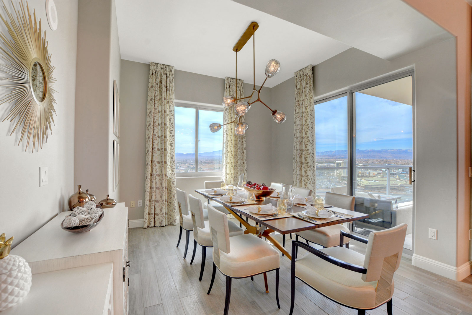 dining room with fancy chandelier and large windows