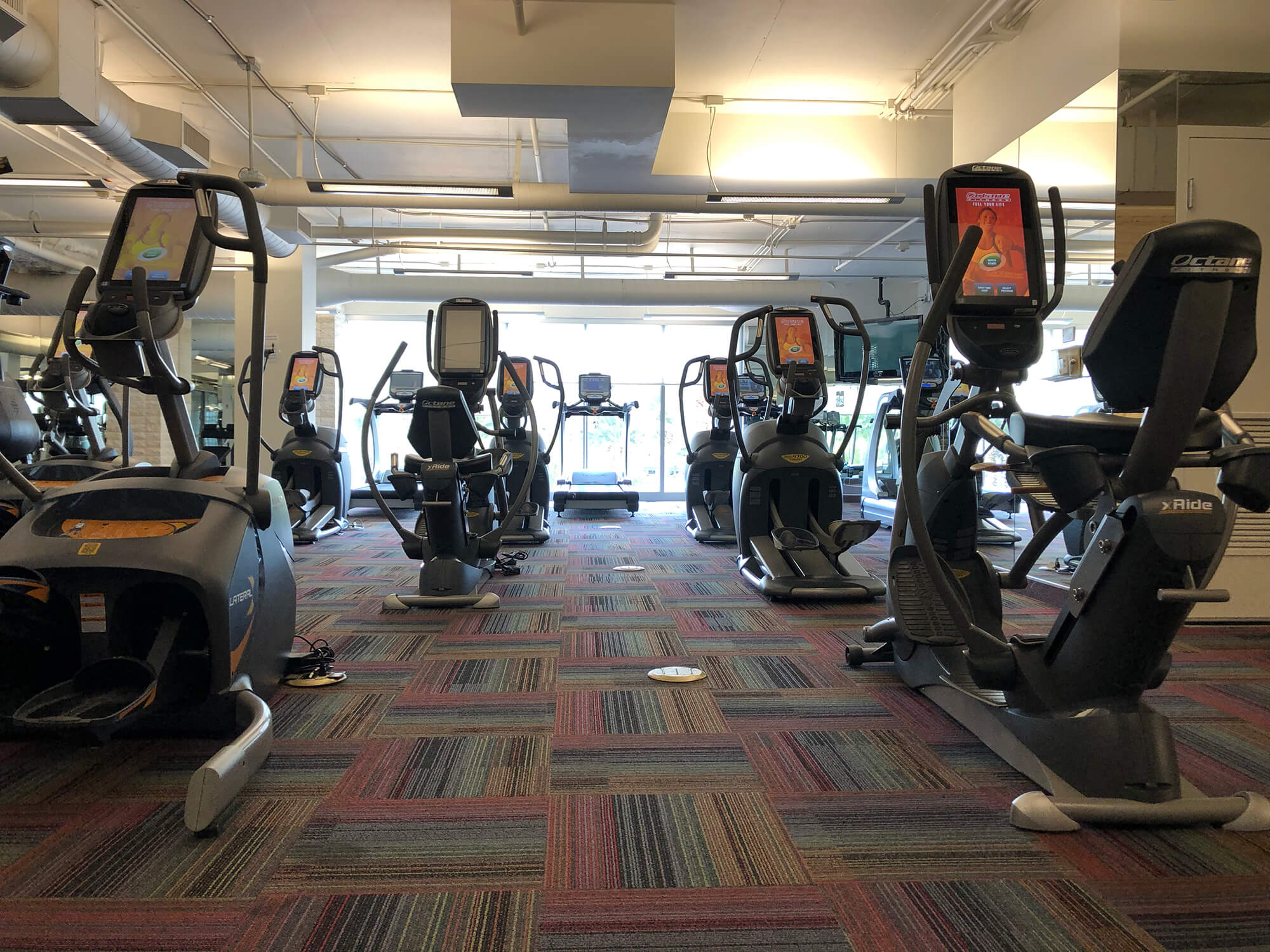 new fitness studio with exercise equipment