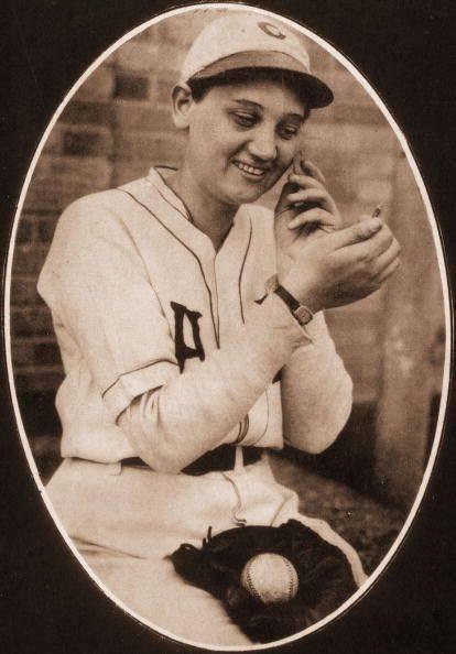 historic image of woman baseball player