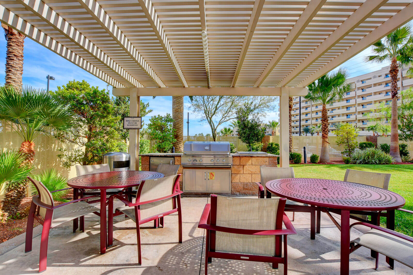 shaded outdoor patio with BBQ