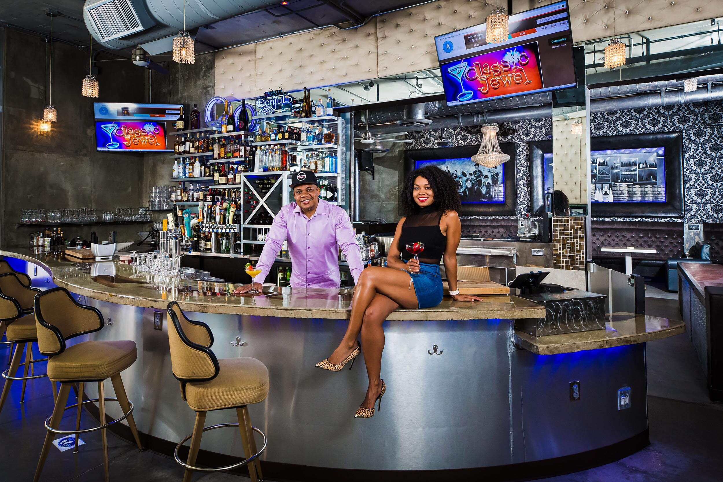 bartenders pose at bar
